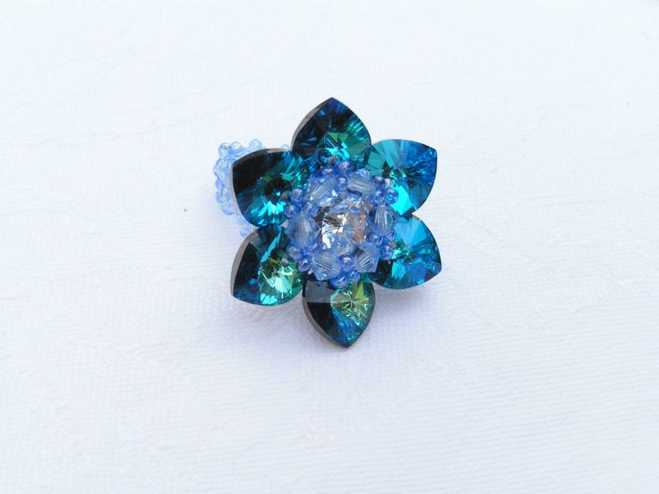 Lotus - Blue Azure ring  -    Elegant, sparkling Swarovski ring which reminds a cloudless summer sky.  The lotus flower diameter is 33 mm. I used flexible fishing line, so everybody can wear.