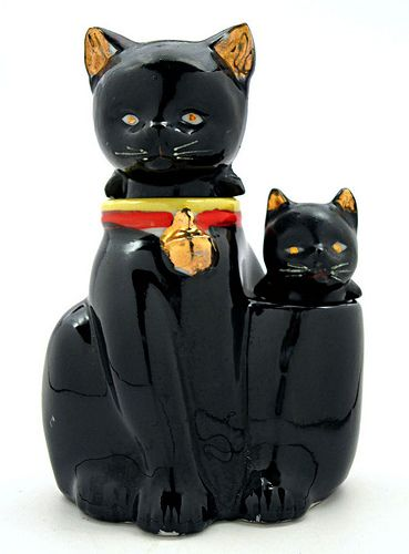Three piece cat and kitten ceramic bobble-head salt and pepper shakers. The two cat heads have cylindrical bases that fit into the cat body stand. Manufacturer unknown. Circa 1950-1975.
