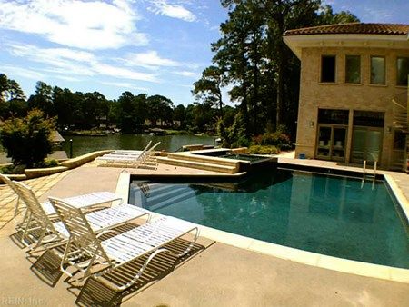 Love this European-inspired, Mediterranean theme pool overlooking the  water. Listing offered by  Property SearchVirginia BeachOasis