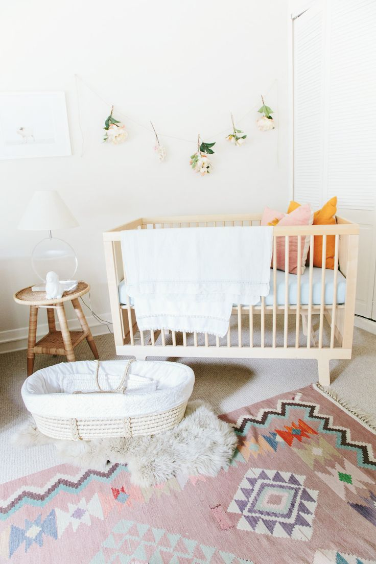Minimalistic nursery with white walls