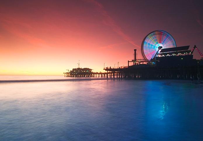 Take in a glowing #California sunset from the beach near Santa Monica Pier.