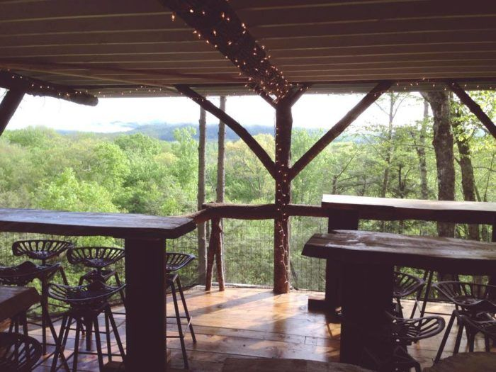 At the back of the restaurant, the ground drops off and an amazing porch extends over the most mind-blowing view. You'll truly feel like you're in a treehouse!