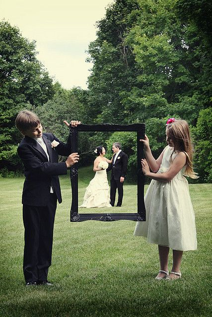 Take them in frame! Taken by Renaissance Studios and seen on  Bridal guide, this family wedding photo idea includes a frame as photo prop.