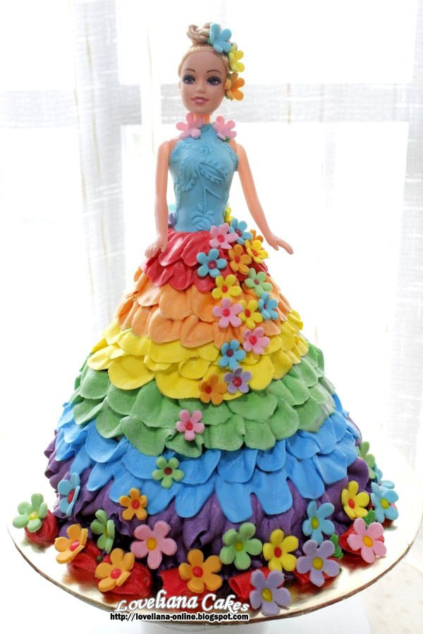 A rainbow barbie cake (buttercream) - Reminds me of the ruffled 60's variety :)