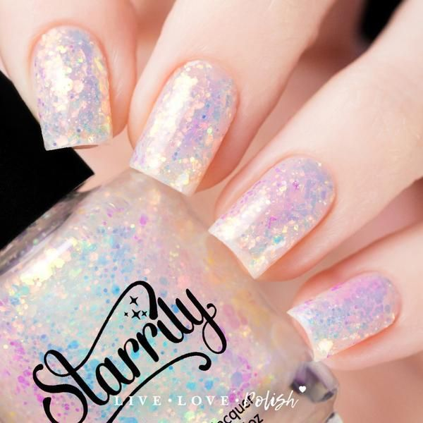 Starrily The Unicorns Are Coming is a glitter topper with iridescent color shifting glitter in a clear base. This nail polish is designed and made in the USA!