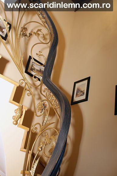 scara interioara de lemn masiv cu mana curenta din lemn curbat cu placare trepte lemn