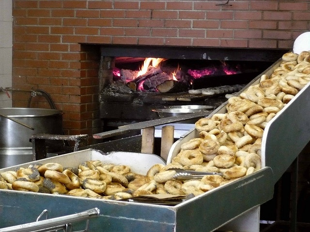 Montreal bagels.     Warm. Brick oven. Seeds at the bottom of a brown paper bag. Devouring 1, 2, maybe 3 right away in the car with my dad.