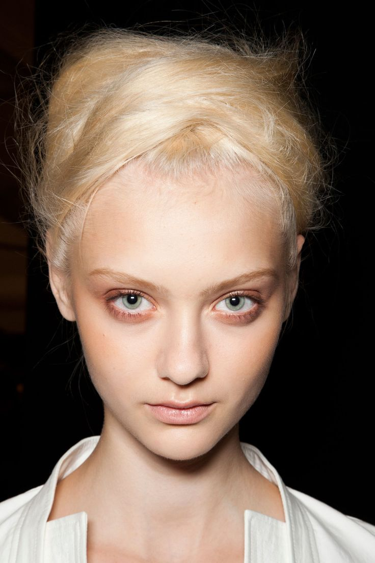 model-neutral makeup by more definition to the eyes with sculptural wrapped hair