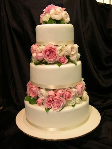 wedding cake with flowers in between layers wedding cake flowers between tiers search 26882