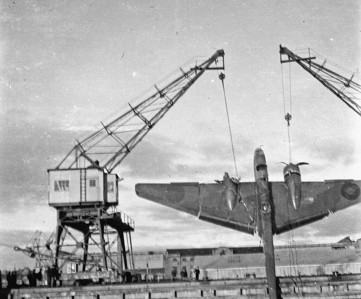 Cranes in the Swedish port of Helsingborg raise a crashed RAF Handley Page Hampden 52 HP.