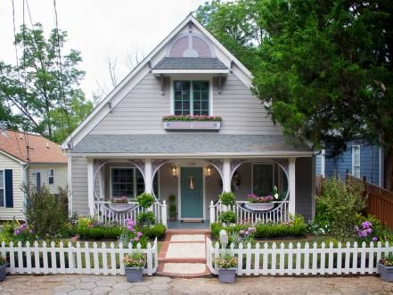 The symmetry of the house, combined with a steep roof and large gable, gave Curb Appeal: The Block host John Gidding the inspiration to add folk-Victorian architectural elements. Window boxes, Victorian spandrels, bracket work and filigree details — along with new brick-detail walkway and loads of beautiful plantings — have completely transformed the home.