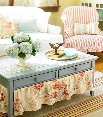 Fabric skirt for coffee table - priceless.  And just think how much stuff you can store under there.