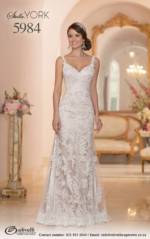 Another gorgeous Lace over Lustre Satin Sheath, red carpet inspired, dress by Stella York. Style 5984 has beautiful vine shoulder straps, a sweep train and low back (see next pic) with a zipper closure that will hug your curves while the V neckline highlights your beautiful face. #StellaYork #OlivelliCT #Wedding #Gown #Dress
