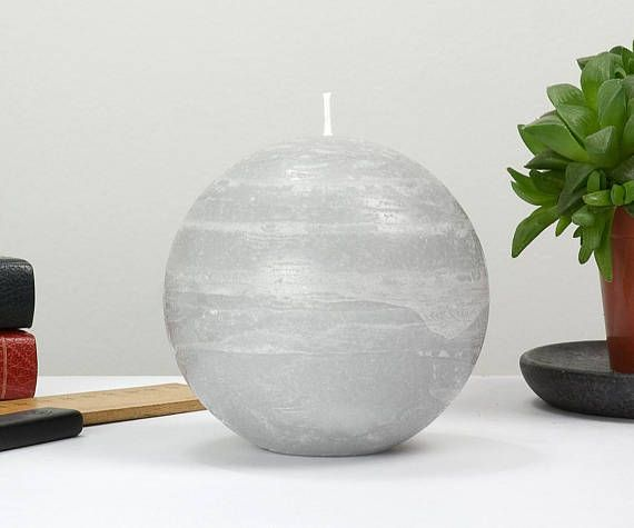 The neutral color of gray, nicely slips into any decor. Ball candles burn exceptionally well and provide some of the most enchanting light as the candle burns down. The 4 ball candles sit nicely on a traditional candle holder meant for 3 pillar candles. • Dimensions: 4 Diameter Ball •