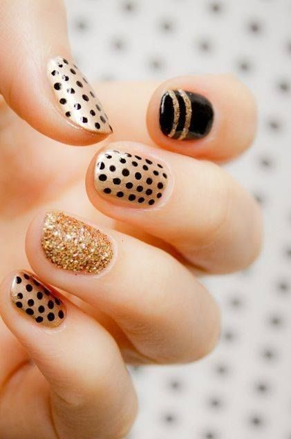 A gold and black manicure perfect for party season. I need to do this for this weekend! MIZ!