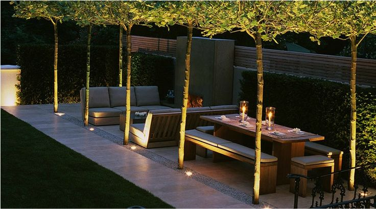 Luciano Giubbilei. The lighting makes this outdoor living area