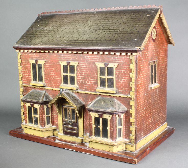 "Lot 151, A good 1920's childs wooden polychrome 2 storey dolls house, dated 1925, 17""h x 20""w x 13""d, est  £150 - 250"