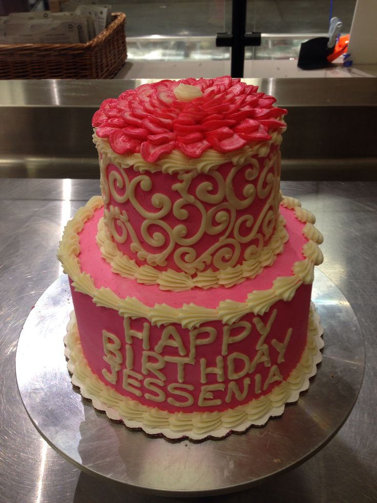 Two Tier Pink Birthday Cake With Scrolls And Piped Flower On Top