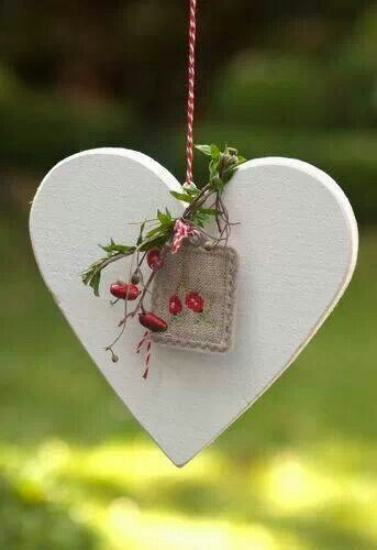White wooden heart, with embroidered linen tag
