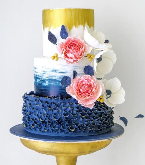 Chic unique blue, gold and white wedding cake; Via Butter Bali