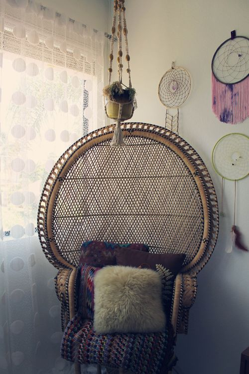 I don't care what anyone says.  I've always wanted a big papa san chair.  I also love the macrame plant holder and dream catchers.  I would love a corner of my bedroom to be like this.