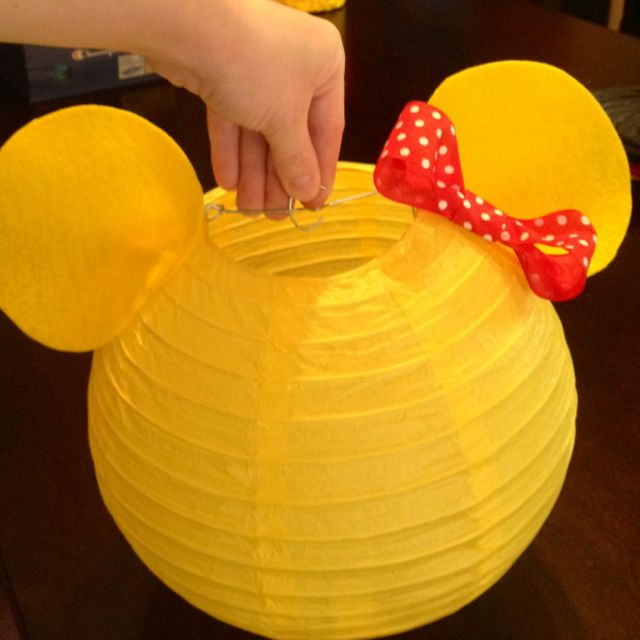 Minnie Mouse paper lantern / felt ears and polka dot ribbon attached with hot glue. @Wendy Aée Alfonso DePalma use different colors but great idea!!