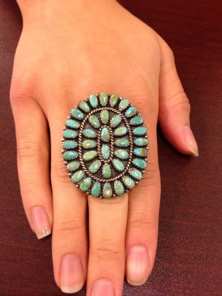 Lot 127a in the special Saturday 9.21.13 online & live auction! Gorgeous, large sterling silver cluster ring with Southwestern / Native American Indian style design featuring polished turquoise stones in sawtooth setting with twisted rope designs. Size: 7, total weight: .48 ozt. #Jewelry #Fashion #POGAuctions