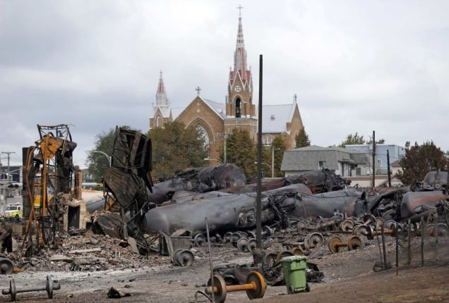 Ed Burkhardt, the president and CEO of the railway's parent company, said he did not believe that what happened to the train was 'malicious or an act of terrorism'. Thirteen unidentified victims have been recovered in the town of Lac-Megantic after the Saturday explosion but nearly 40 people are still missing.
