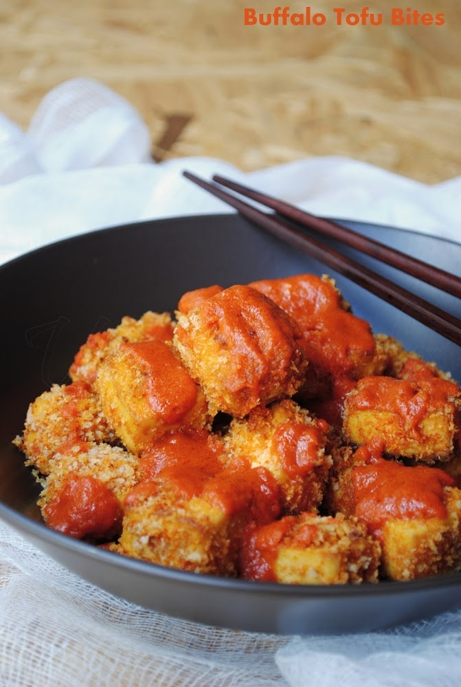 Crisp breaded baked tofu cubes covered with hot yum buffalo sauce
