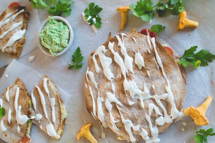 Chanterelle-mushroom quesadilla drizzled with feta sauce