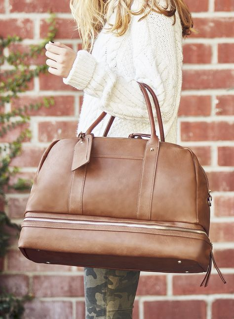 The perfect carry-on travel bag with a bottom compartment for shoes!