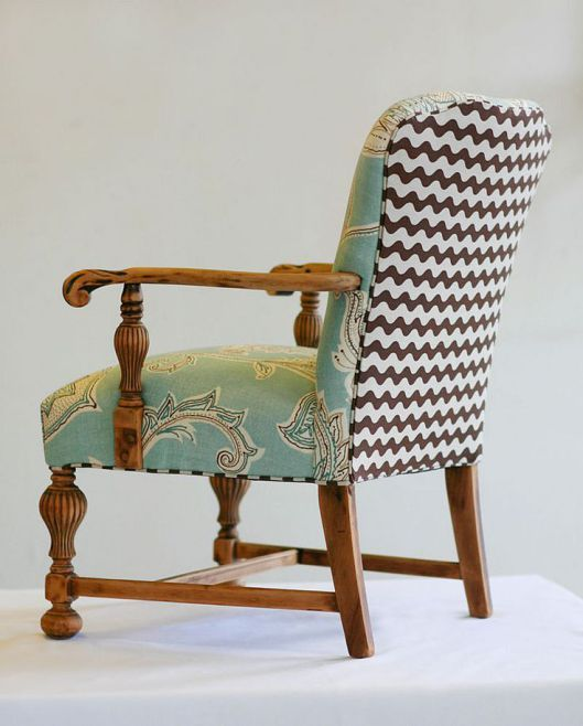 This two fabric combination will fit more easily into a scheme than the patchwork chair. I like the way the Jacobean-inspired material on the seat fits with the medieval look of the chair, with the Chevron stripes adding a modern twist.