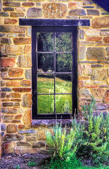 The side window of Lavender Fields Cottage. This beautiful cottage and gardens can be found at Oakbank, Adelaide Hills, South Australia, Australia.