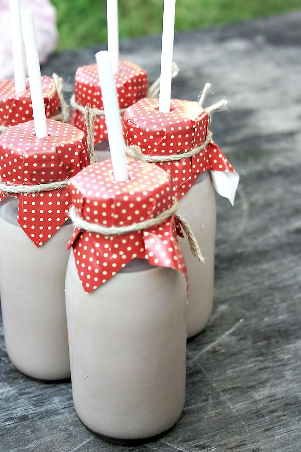 glass milk bottles with paper wrap & jute string. very practical indeed.
