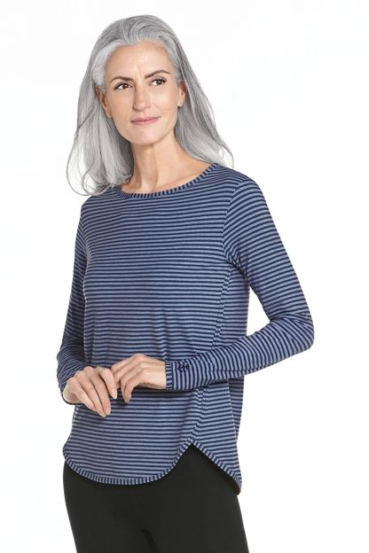 "This side split shirt is one of our favorites! Turn heads with this relaxed fit sun protective top in rich stripped colors designed for travel or everyday wear. With a ""hits at the hip length"" this Side Split Shirt is comfortable and sporty right down to the scoop neckline. Nothing beats comfortable lightweight shirts to wear that include the added benefit of UPF 50+ sun protection for those harmful rays you just don't need."