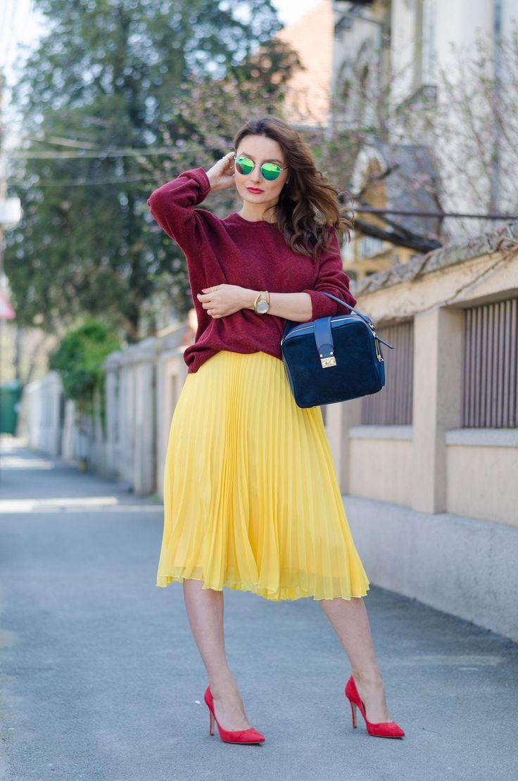 Burgundy Sweater / Yellow pleated skirt / Red stilettos / Made in Italia medium suede bag / Polariod sunglasses  www.cristinafeather.com