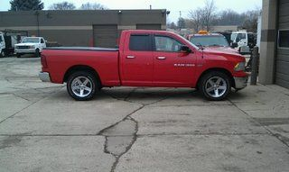 "Red 4th Gen Ram 1500 at stock height with 4"" RCX Lift on the way."
