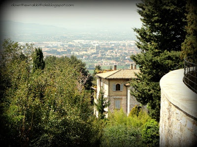 """The view of Umbria from the village of Assisi in Italy. Find out more at """"Down the Wrabbit Hole - The Travel Bucket List"""". Click the image for the blog post."""