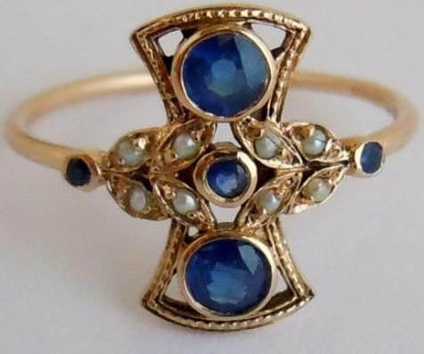 Vintage sapphire and pearl in 9 k gold. Via Diamonds in the Library.