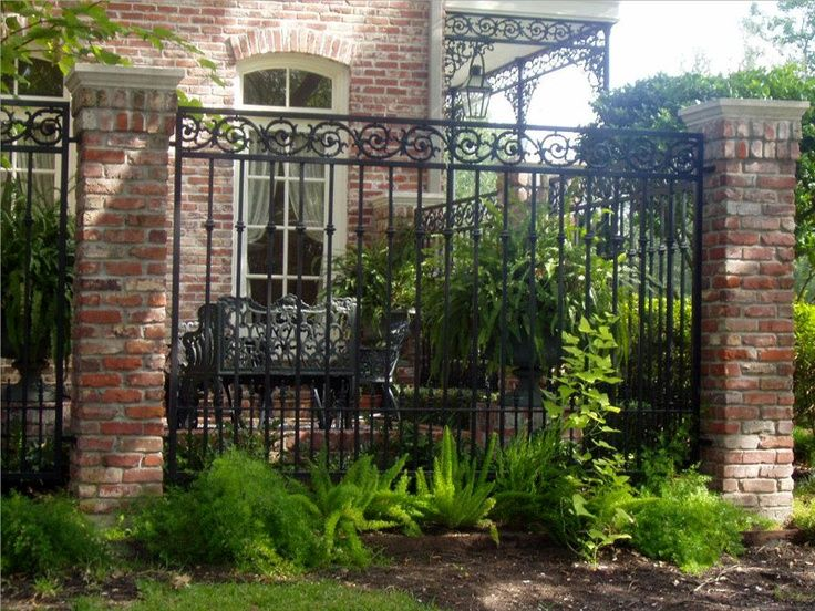 Outdoor spaces landscape design for privacy with brick and for Brick and wrought iron fence designs