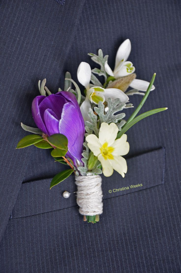 Spring Wedding boutonniere. Seared Purple Crocus, Snowdrops, Primrose, Lavender sprig, Magnolia bud wrapped in string makes this homegrown homemade buttonhole.