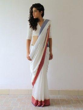 Masculine borders on feminie/plain sarees. White Mehjabeen Silk & Zari Saree By Raw Mango