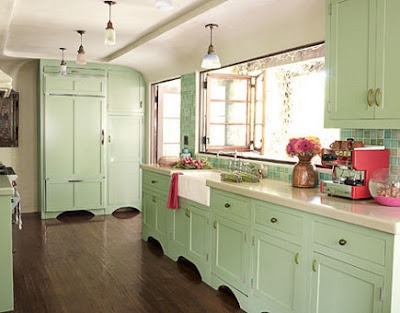 Nice vintage kitchen. The green is pretty. Love the curved ceiling.