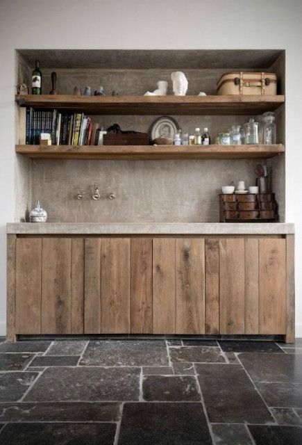 In love with these floors and the rawness of the wood cabinets.
