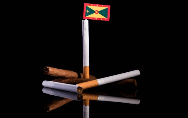 grenada flag with cigarettes and cigars tobacco industry concept