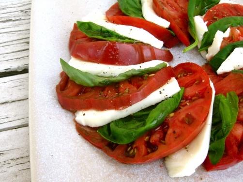 Heirloom Tomato Caprese Salad with basil and fresh mozzarella.