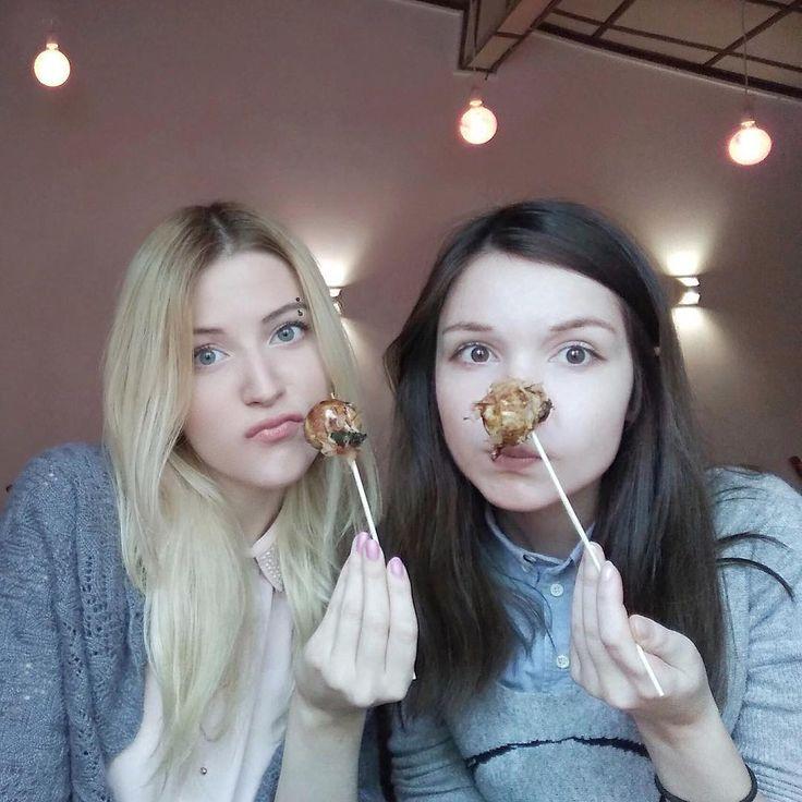 Katya Lischina and her friend eating Takoyaki