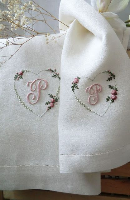 Pretty monograms: Uses alphabet pattern Rouyer 254 and the following thread colours -  DMC 3053, 3022, 948, 224, 746, ecru.  Rouyer 254 from here (scroll down page a little): http://patternmakercharts.blogspot.it/2009/11/rouyer-no-254.html