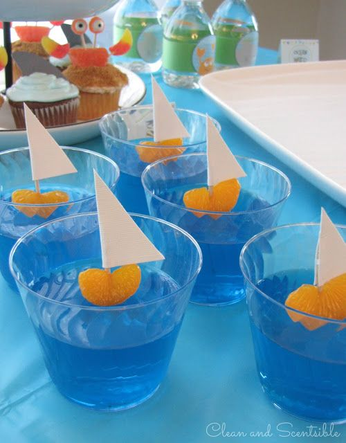 Check out this nautical dessert—blue jello topped with mandarin orange boats. (Clean & Scentsible)