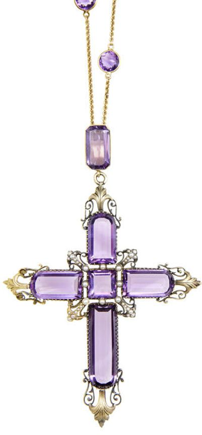 An amethyst cross pendant necklace  The Latin cross set with square and mixed-cut amethyst, each arm terminating in an engraved foliate motif, the centre accented with seed pearls, to a trace-link chain spectacle-set with circular faceted amethyst, lengths: pendant 10.9cm, chain 60.0cm